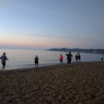 Teams Racing Down the Beach